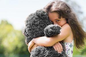 Girl Hugging teddy bear